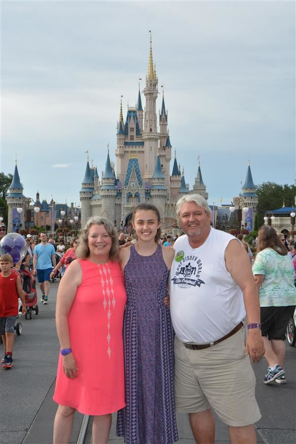 Here is a picture of my husband, daughter, and I at Disney World this summer.