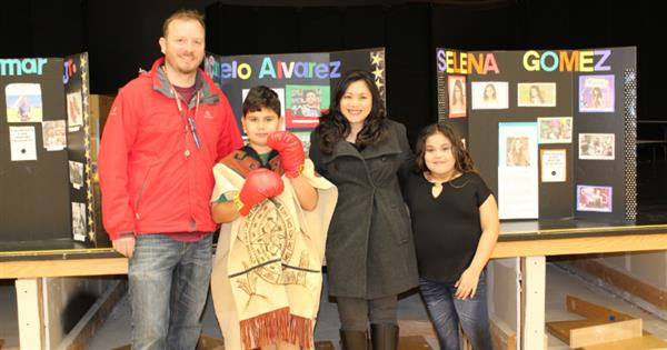 Mr. Winkler, Mrs. Chen, and 2 students dressed as characters for wax museum day