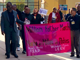 Fathers carry millon father march banner