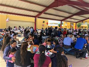 scholars and families eating lunch