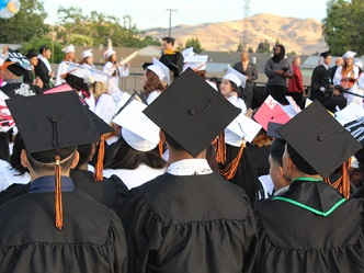 graduates in cap and gown at ceremony